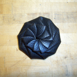 Rotary-folding coin purse, closed.