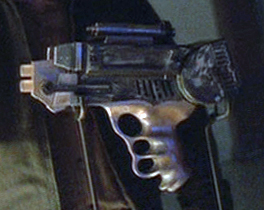 The Lassiter laser pistol from Firefly episode 11.  Note identical handle with toy to right.