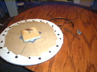 Lazy susan made from 2' MDF circle, bearing, and scrap board. Covered with Scotch-guarded white canvas.
