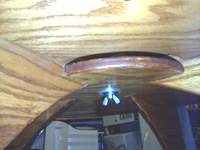 Underside of table showing lazy susan attachment.