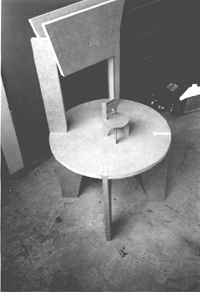 The first prototype of the puzzle chair, here executed in 3/4in. MDF, was wasteful of material and required the use of fasteners. It was also uncomfortable, having a back exactly perpendicular to the plane of the seat.