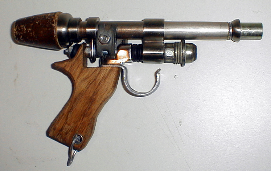 This gun is made from several dozen found objects.  Right click for larger image.