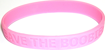 Pink rubber awareness bracelet with slogan SAVE THE BOOBIES.